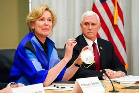 In this March 5, 2020, photo, Dr. Deborah Birx, Ambassador and White House coronavirus response coordinator, holds a 3M N95 mask as Vice President Mike Pence visits 3M headquarters in Maplewood, Minn., in a meeting with 3M leaders and Minnesota Gov. Tim Walz to coordinate response to the COVID-19 virus.