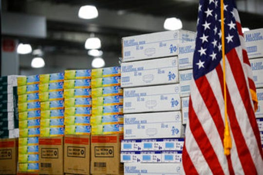 In this March 24, 2020 photo, stacks of medical supplies are housed at the Jacob Javits Center that will become a temporary hospital in response to the COVID-19 outbreak in New York.