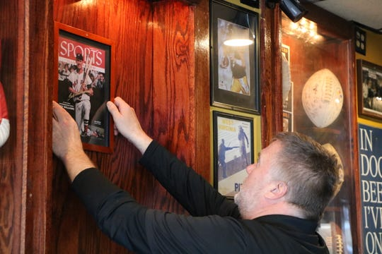 "Ever since COVID-19 began shutting down restaurants in March Douglas ""Buxy"" Buxbaum, owner of Buxy's Salty Dog Saloon and Dry Dock 28 in Ocean City, has been trying to find jobs around his restaurants to keep him busy. One job that's kept him busy is his sports memorabilia. Taking some down and putting others up."