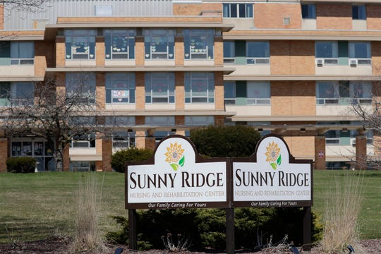 The exterior of Sunny Ridge nursing home as seen Sunday, April 5, 2020, in Sheboygan, Wis.  The home was the scene of the first COVID-19 death in the county and several staff members have come down with the potentially fatal virus.