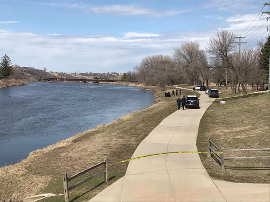 Authorities responded to an incident along the Big Sioux River on Sunday afternoon, blocking off a portion of the bike trail north of Sixth Street.