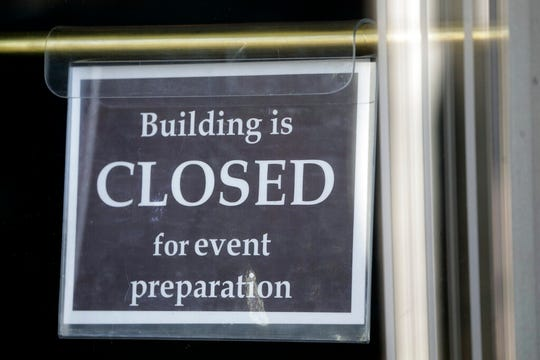 "A ""building is closed"" sign is shown at an entrance of The Church of Jesus Christ of Latter-day Saints' Conference Center during the 190th Annual General Conference Saturday, April 4, 2020, in Salt Lake City. The twice-annual conference kicked off Saturday without anyone attending in person and top leaders sitting some 6 feet apart inside an empty room viewed via live-stream as the faith takes precautions to avoid the spread of the coronavirus. It is the first conference without a crowd since World War II, when wartime travel restrictions were in place. (AP Photo/Rick Bowmer)"