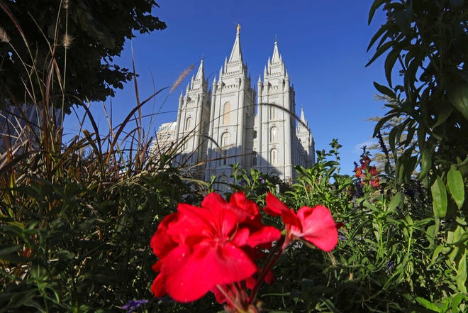 FILE - This Oct. 4, 2019, file photo, shows the Salt Lake Temple at Temple Square in Salt Lake City. For the first time in more than 60 years, top leaders from The Church of Jesus Christ of Latter-day Saints will deliver speeches at the faith's signature conference this weekend without anyone watching in the latest illustration of how the coronavirus pandemic is altering worship practices around the world. The twice-yearly conference normally brings some 100,000 people to the church conference center in Salt Lake City to watch five sessions over two days. This event, though, will be only a virtual one. (AP Photo/Rick Bowmer, File)