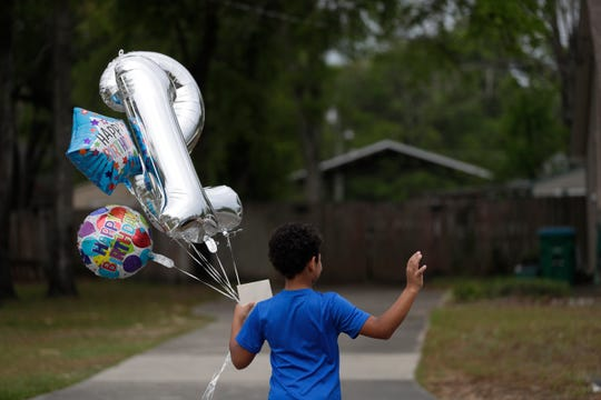 Friends and family parade through Hayden Reed's Crawfordville neighborhood to celebrate his 12th birthday Sunday, April 5, 2020.