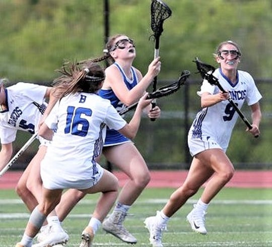 North Salem's Jenna Shaughnessy (center in blue) plays against Bronxville in last year's Section 1 Class D championship. The Tiger senior will  play lacrosse next year for Virginia's Randolph Macon College. (Photo: Frank Becerra/The Journal News)