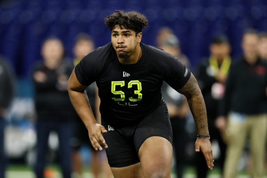 Iowa offensive lineman Tristan Wirfs runs a drill at the NFL football scouting combine in Indianapolis, Friday, Feb. 28, 2020. (AP Photo/Charlie Neibergall)