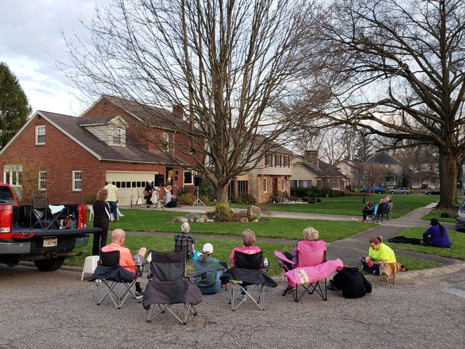 John and Hanna Mohr play a concert in the driveway of their Marion Avenue home in Zanesville on Saturday.