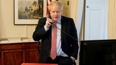 British Prime Minister Boris Johnson speaks on the telephone to Queen Elizabeth II on March 25, 2020 in London, England.