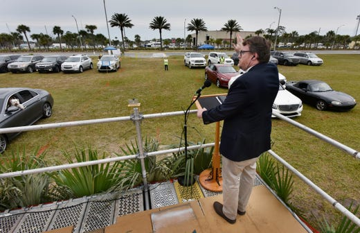 Senior Pastor David Ball of the Church of Our Savior on Beach Boulevard delivers his sermon on Palm Sunday at a drive-in church service  Sunday, April 5, 2020 in the middle of the coronavirus pandemic in Jacksonville Beach, Fla. The congregation stayed in their cars and listened on their radios.