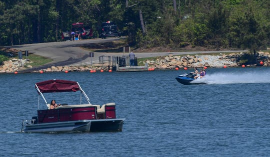 A pontoon boat and a personal watercraft near the Asbury Boat Ramp on Lake Hartwell in Anderson County in April 2020.