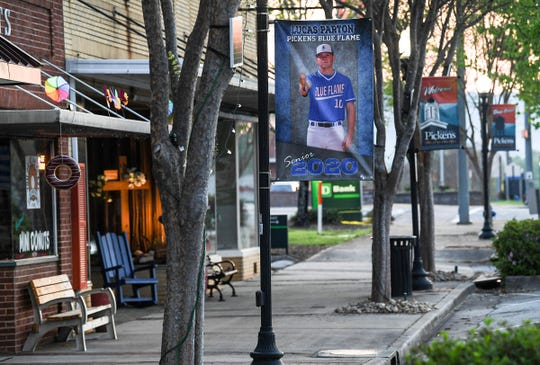 Baseball player Lucas Parton, seen in one of 17 banners along Main Street in Pickens honoring Pickens High School senior athletes.