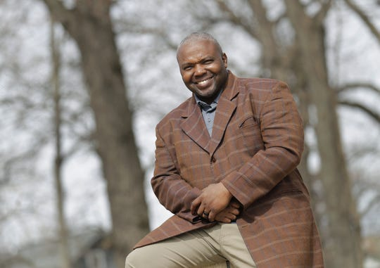 Appleton school board member Alvin Dupree, known for spearheading the community movement against the district's now-disbanded truancy court and controversy surrounding a Christian-themed graduation speech, has decided to step back from the board. He is seen here at City Park April 6 in Appleton.