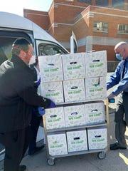 Members of Lakewood's Bikur Cholim deliver meals to hospital staff.