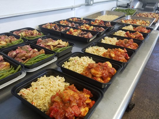 Prepared meals from Foodini's Catering in Neptune.
