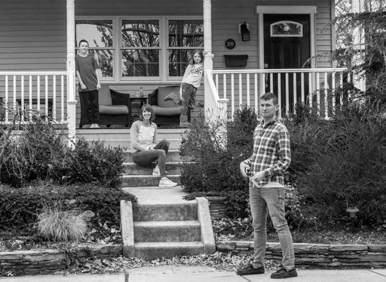 The Nicely family of Collingswood - Adam and Kate and their children Wilder and Lydia - pose for a porch portrait taken by photographer Kevin Monko.