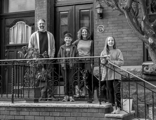 The Malcarney family of Philadelphia - Chris and Chrissy, their children Matt and Maura, and dog Pepper pose for a porch portrait taken by photographer Kevin Monko.