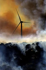 A wildfire burns around a wind turbine in central Texas in 2006.