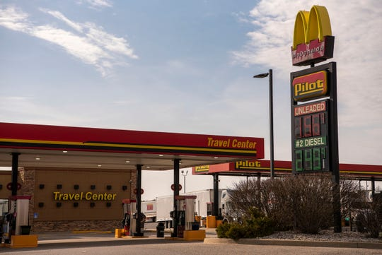 Pilot Travel Center, on 11 Mile Rd., sells gas for 1.56 per gallon on Monday, April 6, 2020 in Battle Creek, Mich. Across the country, gas prices are plummeting as states enforce stay-at-home orders to slow the spread of COVID-19.
