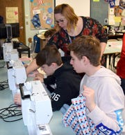 Kerry Motell, a Family and Consumer Science Teacher at Vestal Middle School, has been sewing fabric masks for local heath care workers. Here, she's pictured in the classroom teaching students to sew pillowcases.