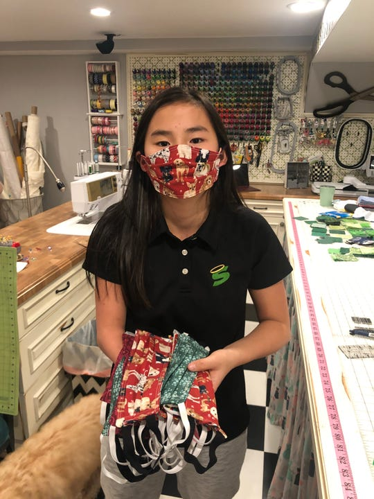 Annie Kate Myers,an 11-year-old fifth grader at All Saints School in Endicott, has been sewing masks for local healthcare workers. She was born without a right hand and has learned to sew one-handed.