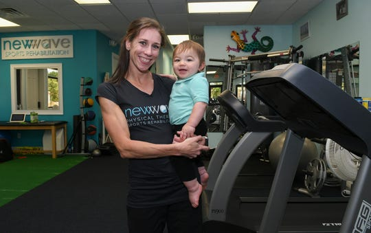 Kaitlin Donner and her son Chris pose for pictures at New Wave Sports Rehabilitation.  Mandatory Credit: Craig Bailey/FLORIDA TODAY via USA TODAY NETWORK