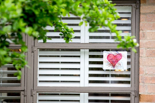 Hearts on windows, doors and in yards can be seen throughout the Lamar Park neighborhood in Corpus Christi, TX. It was designed as a way to help entertain children who are home during the coronavirus pandemic.