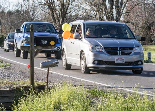 A birthday parade of vehicles passes by Jayden Noble's house on April 2, 2020. Noble celebrated his 16th birth while quarantined due to the corona virus social restrictions.