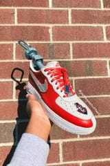 A pair of Nike Air Force 1's Javon Dixon customized to include the Austin Peay Governors logo.