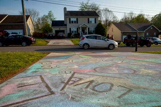 The Iafelice family planned and decorated their driveway with chalk art spanning each concrete slab on Cyprus Court in Clarksville, Tenn., on Sunday, April 5, 2020.