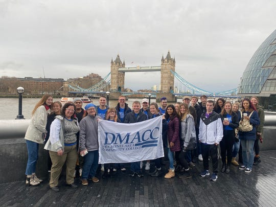 Des Moines Area Community College students and instructors display a DMACC flag in front of the Tower Bridge in London, England in February. Lauren Rice, front left, served as a coordinator for the program. The program was cut several weeks short by the COVID-19 pandemic and students and staff returned home early