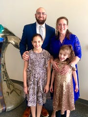 Benji and Sarah Rosenzweig with daughters Na'amah, 10 and Ellah, 9.