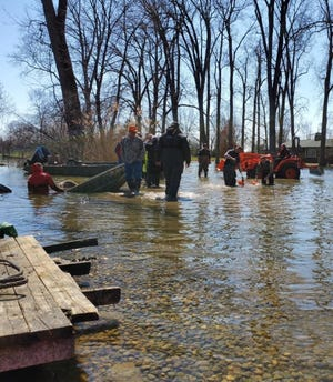 The recovery efforts from the Flat Rock Police Department on the Huron River Sunday, April 5, 2020.