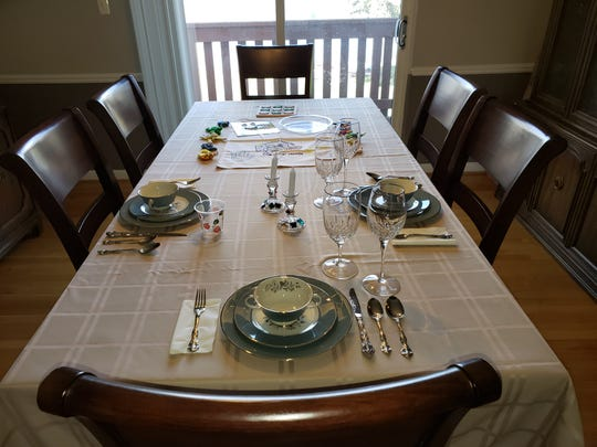 Micki Rubinstein's Passover table is set for three, typically she sets up for 20.