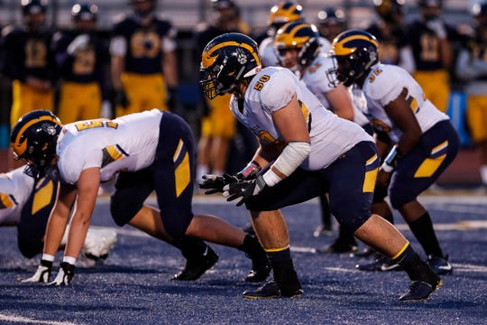 Clarkston offensive tackle Rocco Spindler (50) during the second half against Oxford at Oxford High School in Oxford, Friday, Sept. 27, 2019.