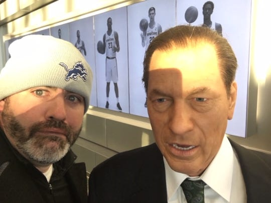 Matt Charboneau with Tom Izzo. One of these is a wax figure. You figure out who.