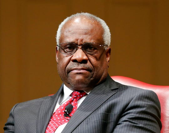 In this Feb. 15, 2018, file photo, Supreme Court Associate Justice Clarence Thomas sits as he is introduced during an event at the Library of Congress in Washington.