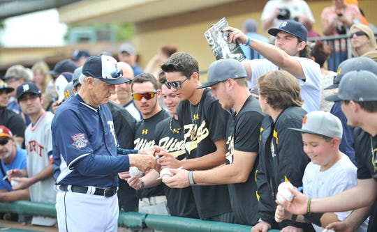 Al Kaline signs autographs for fans during spring training in 2015.
