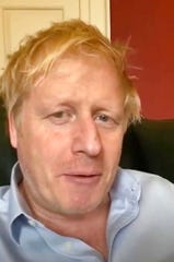 In this image taken from video of the TWITTER/@BorisJohnson, Britain's Prime Minister Boris Johnson speaks from self isolation which he has been in since contracting coronavirus in this April 3, 2020, file photo.
