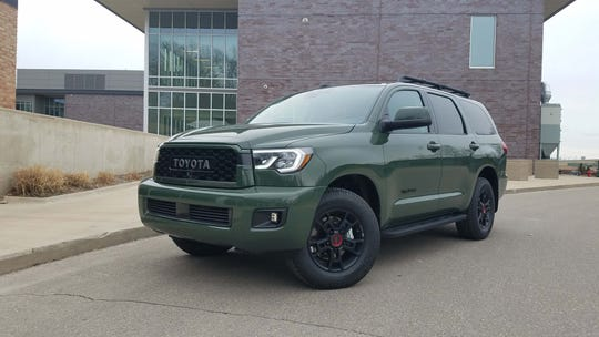 The 2020 Toyota Sequoia can take big families to school or, with its new green Army trim, troops into battle.