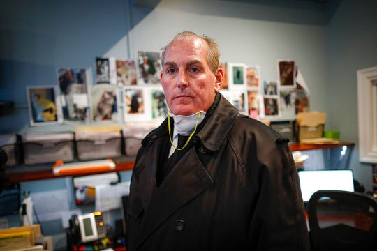 Funeral director Tom Cheeseman stands in his office during a long workday, Friday, April 3, 2020, in Brooklyn.