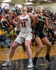 Port Huron's Emma Trombly (11) averaged 13.5 points, 8.8 rebounds and 2.9 steals to help Port Huron win the MAC Red/White tournament championship and earn 21 straight victories.