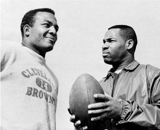 In this Jan. 11, 1964, file photo, fullback Jim Brown, left, and flanker back Bobby Mitchell, once a feared duo for the Cleveland Browns before Mitchell was dealt to Washington, are back together as teammates, as they prepare for the annual Pro Bowl at Los Angeles. Mitchell, the speedy late 1950s and '60s NFL offensive star with Cleveland and Washington, has died. He was 84. The Pro Football Hall of Fame said Sunday night, that Mitchell's family said he died in the afternoon.