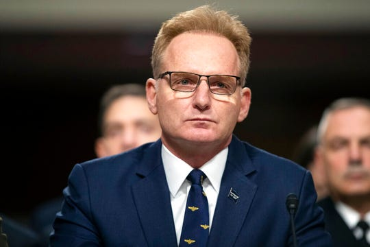"""In this Dec. 3, 2019, file photo, acting Navy Secretary Thomas Modly testifies during a hearing of the Senate Armed Services Committee. Modly says the captain of the COVID-stricken aircraft carrier who was fired last week had betrayed his service and may have been """"too naive or too stupid"""" to be commanding officer of the ship."""