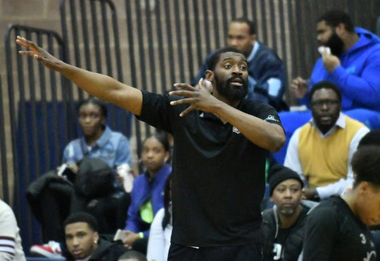 Coach Shane Lawal led the Detroit Renaissance girls basketball team to a 22-2 record this season.