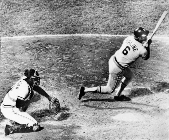 Al Kaline of the Detroit Tigers hits his 3,000th hit of his career, Sept 25, 1974, in Baltimore. The hit came off Orioles Dave McNally and enabled Kaline to become the 12 player in major league baseball history to reach the 3,000-hit plateau. Baltimore catcher is Andy Etchebarren.