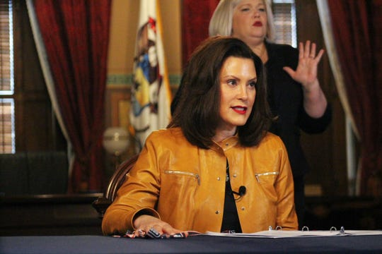 Michigan Governor Gretchen Whitmer speaks during a televised update on COVID-19.