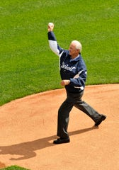 Al Kaline, celebrating his sixth decade with the Tigers organization, throws out the ceremonial first pitch on Opening Day in 2012.