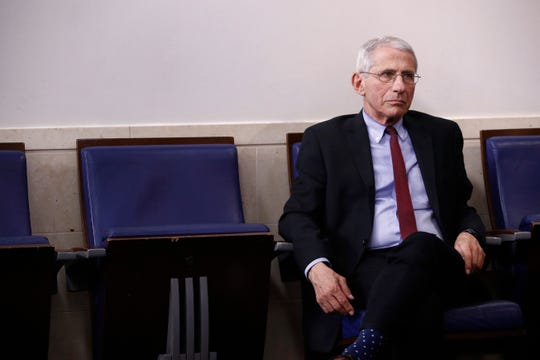 Dr. Anthony Fauci, director of the National Institute of Allergy and Infectious Diseases, listens as President Donald Trump speaks during a coronavirus task force briefing at the White House, Sunday, April 5, 2020, in Washington. (AP Photo/Patrick Semansky)