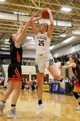Whitney Sollom (25) averaged 10.6 points and 9.7 rebounds for Hartland.