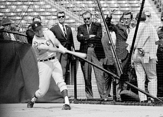Tigers outfielder Al Kaline swings away in the batting cage at Busch Stadium in St. Louis on Oct. 1, 1968, as he worked out for the World Series opener against the Cardinals.